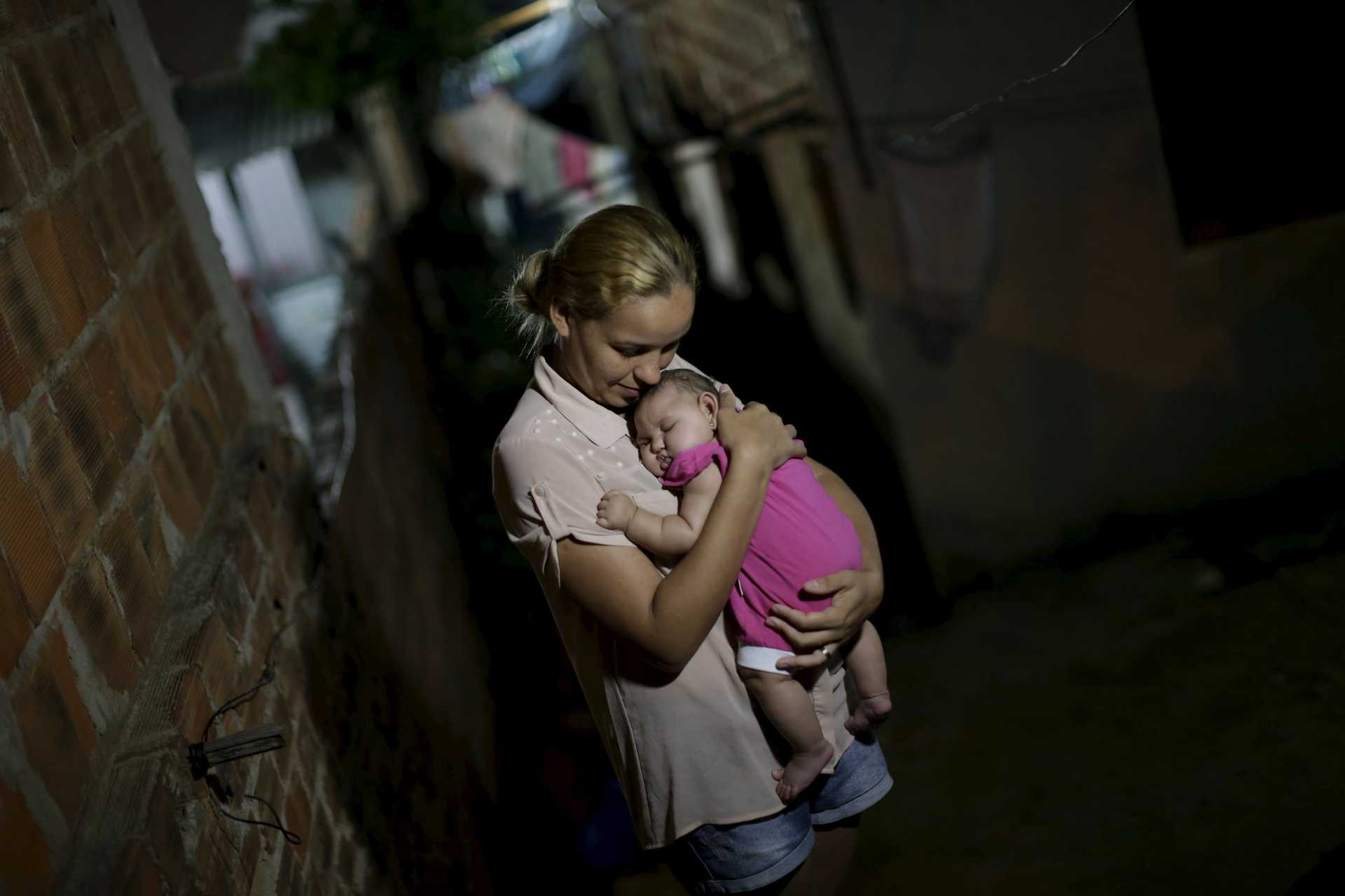Gleyce Kelly embraces her daughter Maria Geovana, who has microcephaly, in Recife