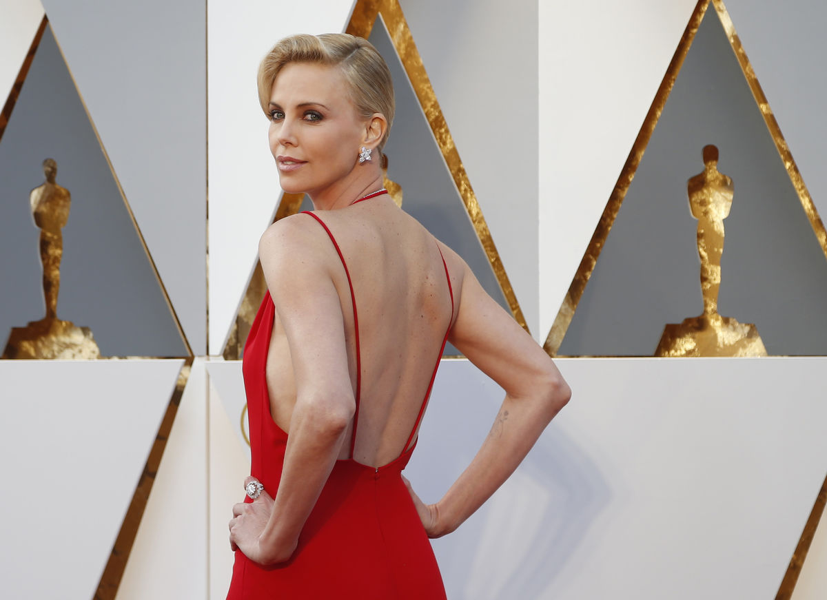 Presenter Charlize Theron arrives at the 88th Academy Awards in Hollywood