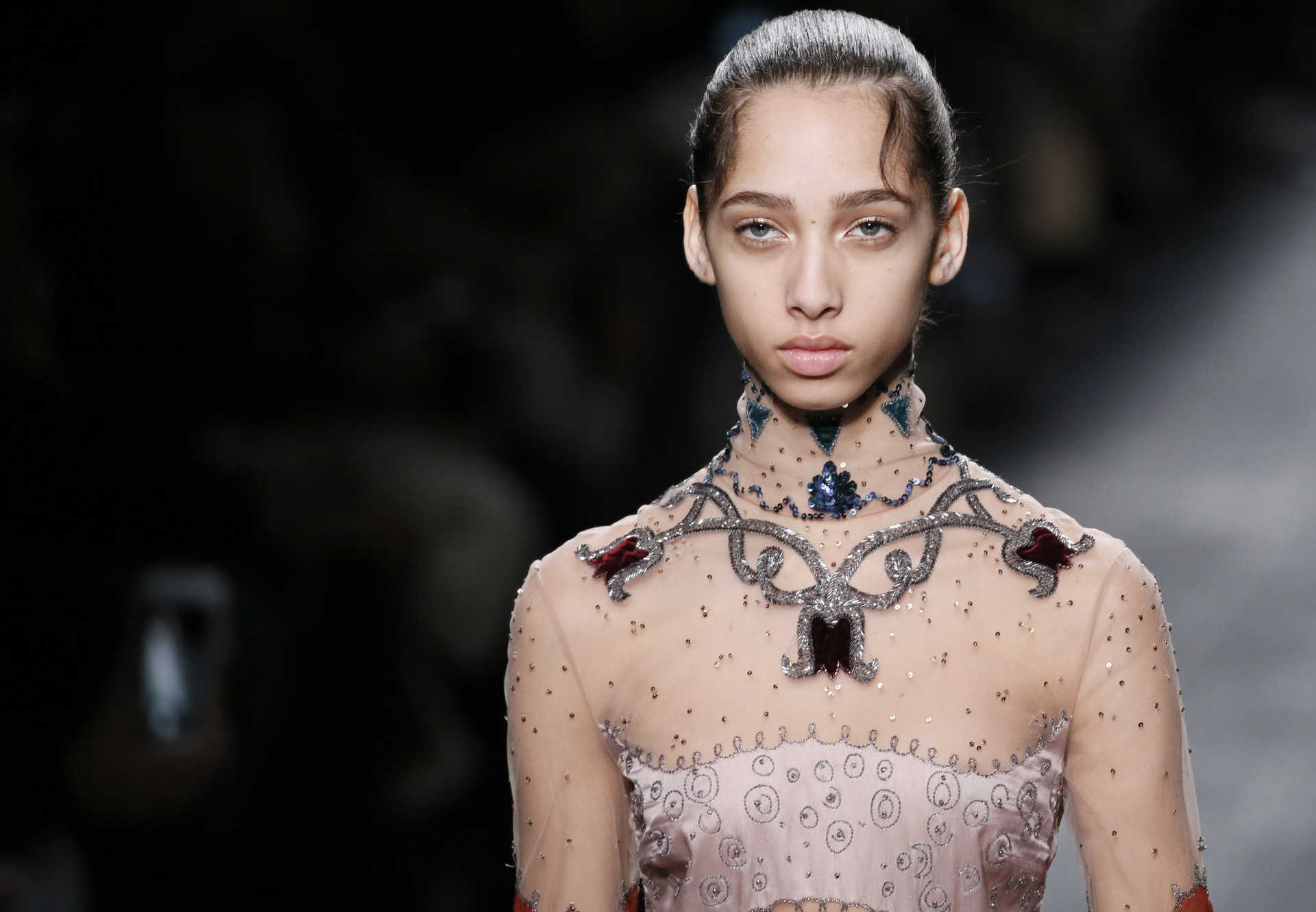 A model presents a creation by Italian designers Maria Grazia Chiuri and Pier Paolo Piccioli as part of their Fall/Winter 2016/2017 women's ready-to-wear collection for fashion house Valentino in Paris