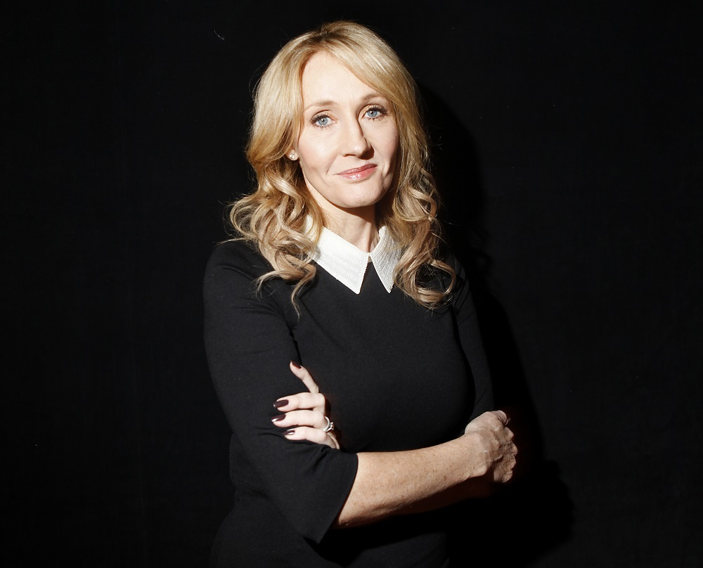 "Author J.K. Rowling poses for a portrait while publicizing her adult fiction book ""The Casual Vacancy"" at Lincoln Center in New York October 16, 2012. REUTERS/Carlo Allegri (UNITED STATES - Tags: ENTERTAINMENT PROFILE SOCIETY PORTRAIT) - RTR398HR"