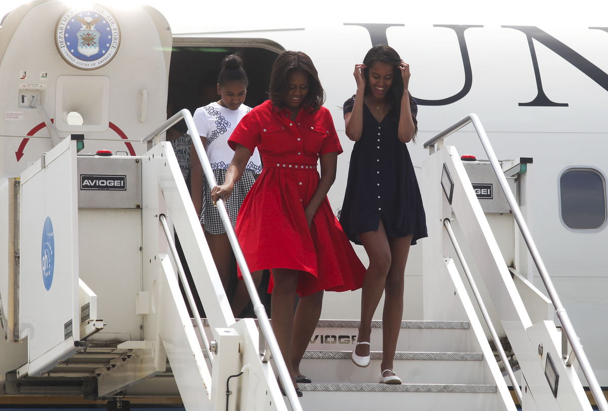 U.S. first lady Obama arrives with her daughters Sasha and Malia at Marco Polo airport in Venice