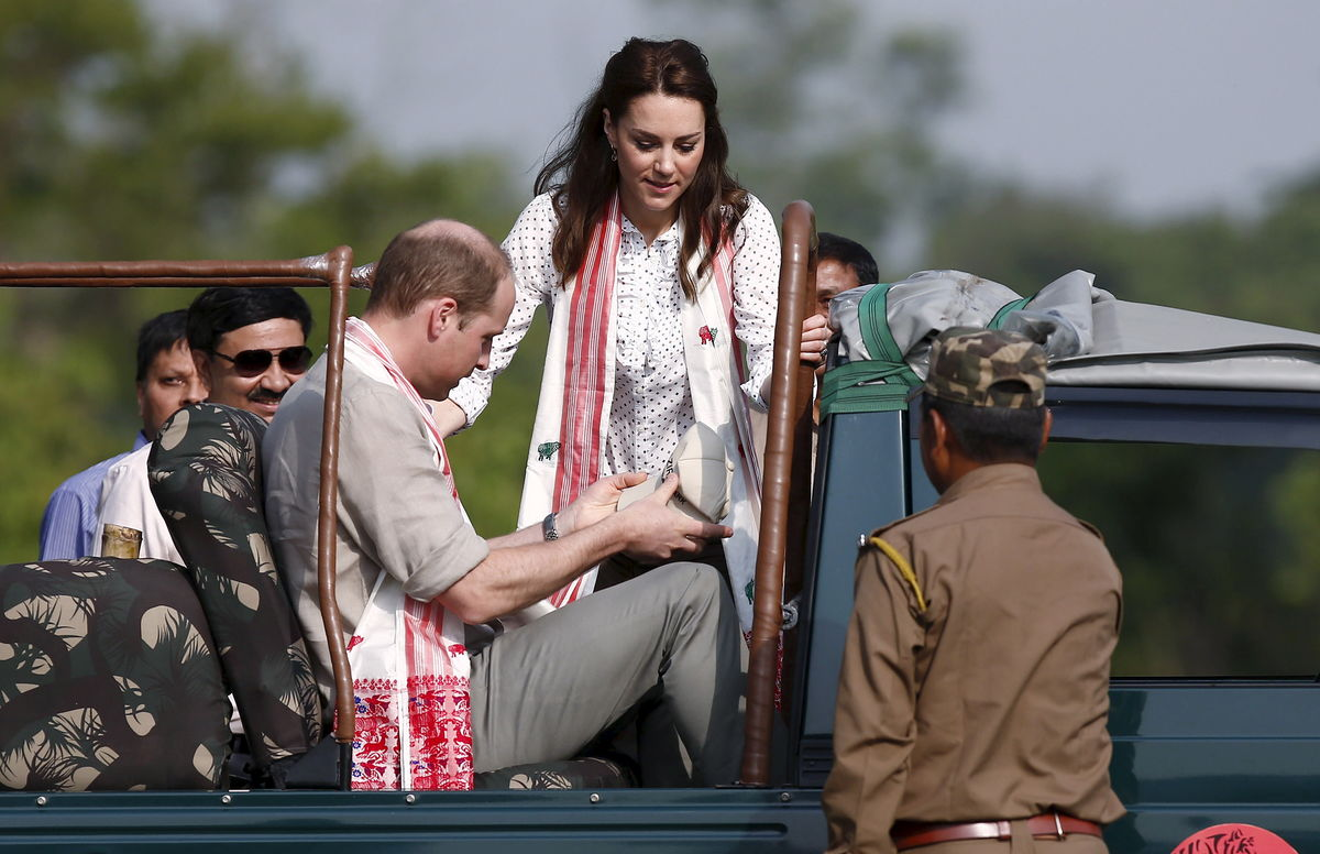 Britain's Prince William and his wife Catherine, the Duchess of Cambridge, sit in a jeep as they prepare to go on a safari at at Kaziranga National Park in Assam