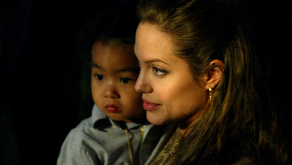 U.S. actress Angelina Jolie and her son Maddox arrive in Saint Marco Square in Venice.