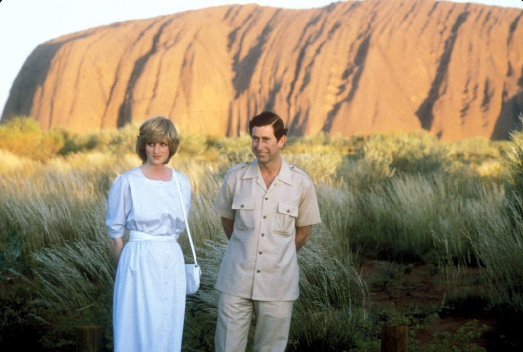 Prince Charles and Princess Diana pose at Ayers Rock, Australia at sunset