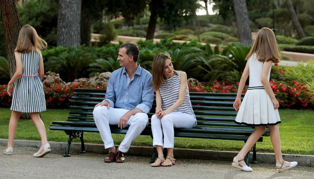 Spain's King Felipe and his daughter Princess Sofia pose during a photocall in the gardens of the Marivent Palace in Palma de Mallorca