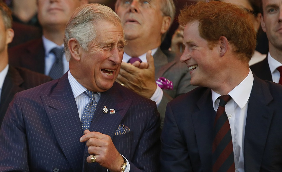 Britain's Prince Charles and Prince Harry laugh during the opening ceremony of the Invictus Games at the Queen Elizabeth Park in east London