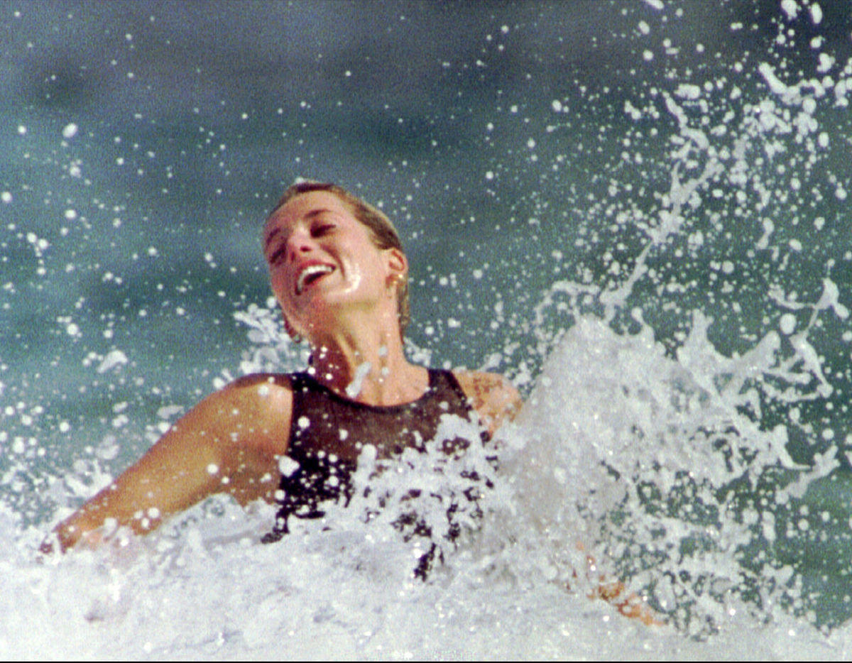 Princess of Wales frolicks in the surf during a beach outing on the Caribbean island of St Kitts jan..