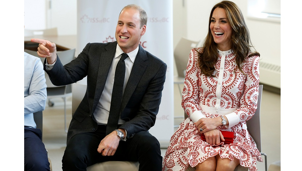 Britain's Prince William and Catherine, Duchess of Cambridge, react during a visit to the Immigrant Services Society in Vancouver, British Columbia