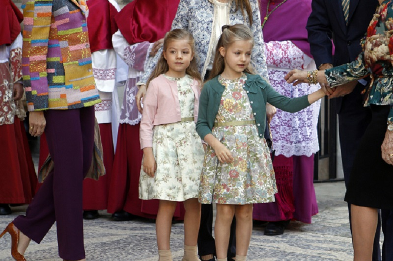 Spain's Infantas Sofia and Leonor wait to enter Mallorca cathedral for Easter mass