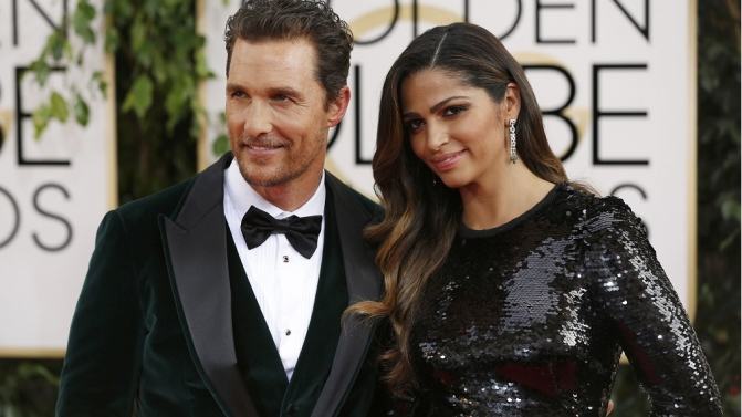 Actor McConaughey arrives with Alves at the 71st annual Golden Globe Awards in Beverly Hills