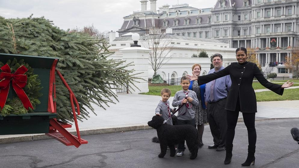 First Lady Michelle Obama welcomes the arrival of the Official White House Christmas Tree