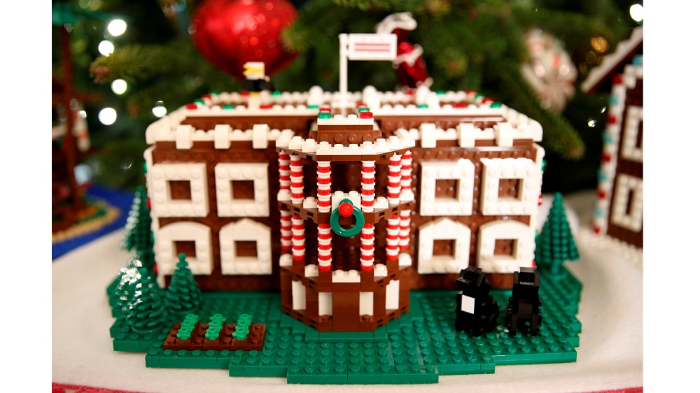 The Lego gingerbread White House is seen in the State Dining Room during a holiday decor preview at the White House in Washington