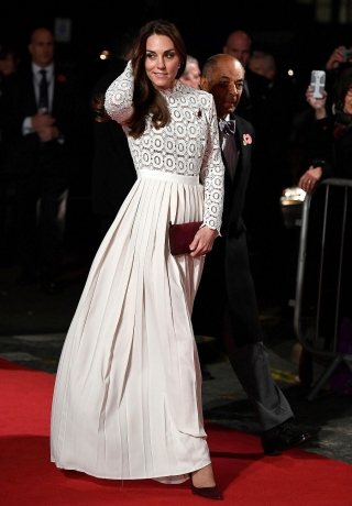 "Britain's Catherine, Duchess of Cambridge poses as she arrives for the world premiere of ""A Street Cat Named Bob"" at The Curzon Mayfair in London"