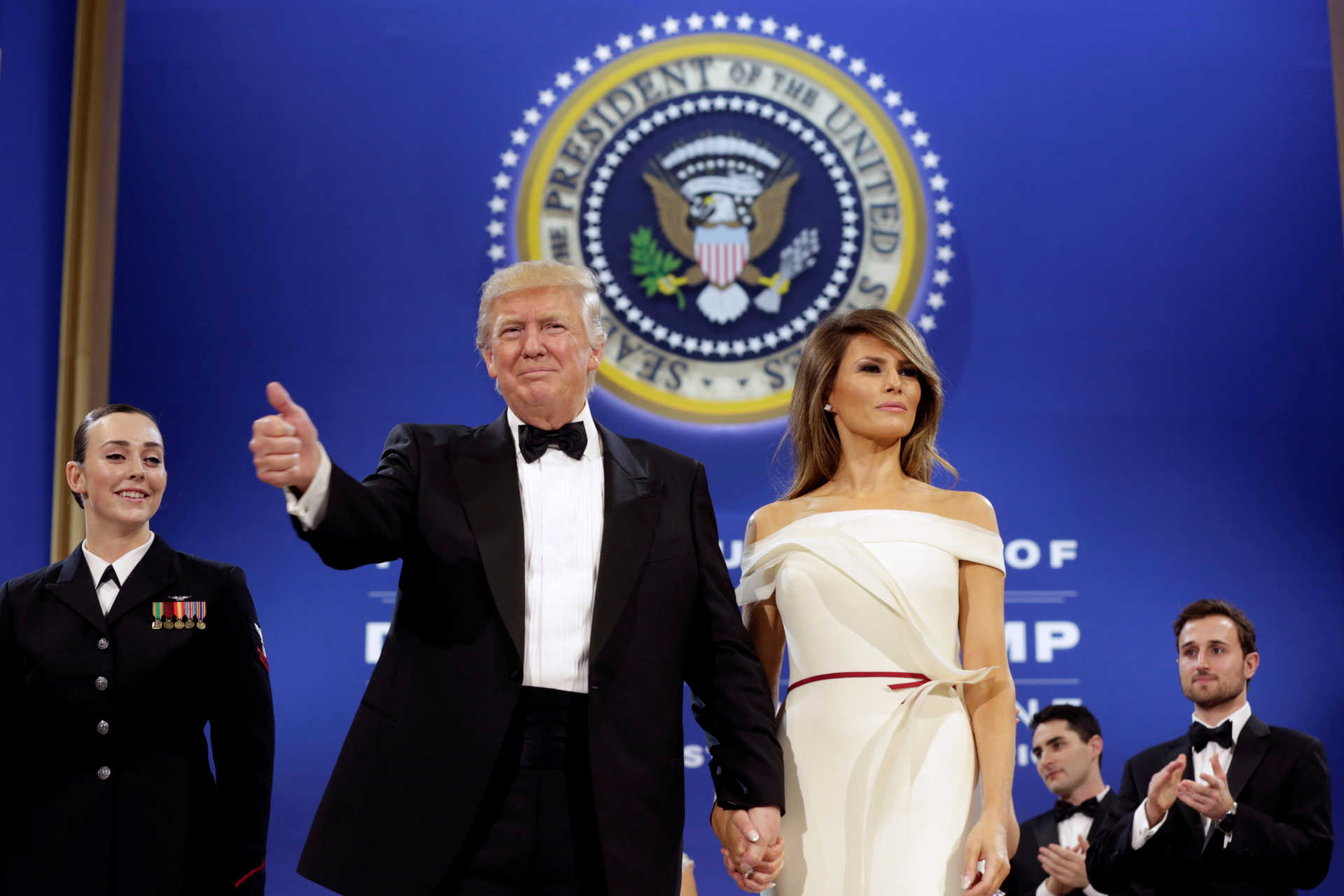 President Donald Trump salutes with his wife Melania