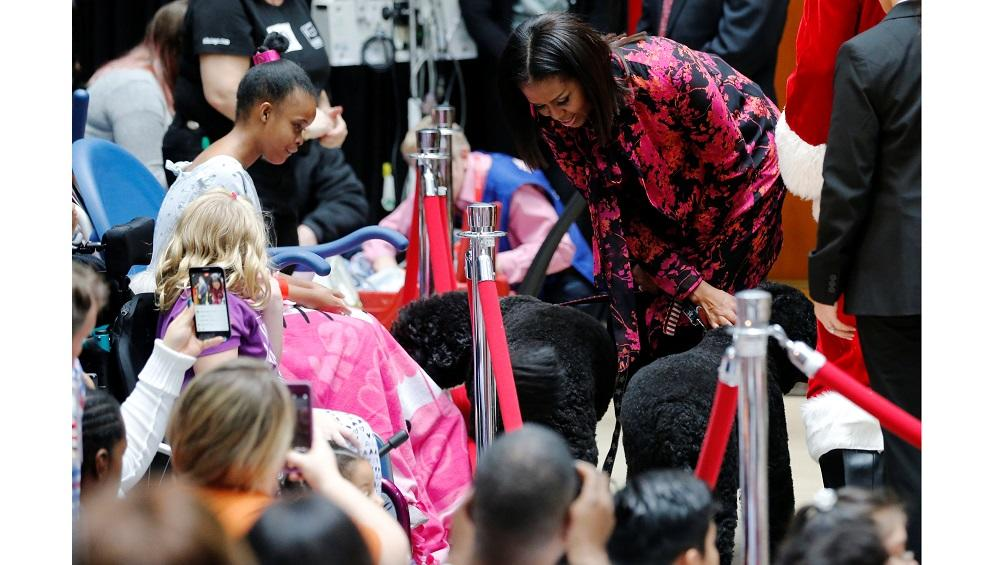 U.S. First Lady Michelle Obama and her pet dogs visit with patients at Children's National Medical Center in Washington