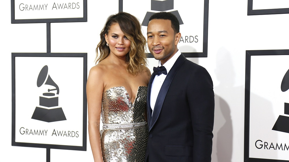 John Legend and his wife Chrissy Teigen arrive at the 56th annual Grammy Awards in Los Angeles