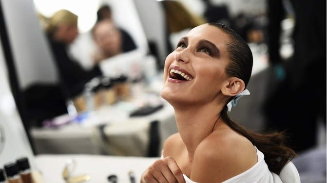 Model Bella Hadid smiles as she has her make-up applied inside Blenheim Palace ahead of a Dior fashion show in Woodstock