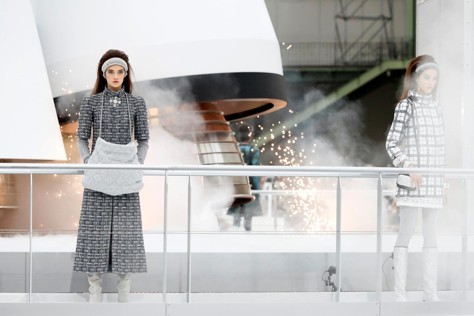 Models present creations by German designer Karl Lagerfeld as part of his Fall/Winter 2017-2018 women's ready-to-wear collection for fashion house Chanel during Fashion Week in Paris