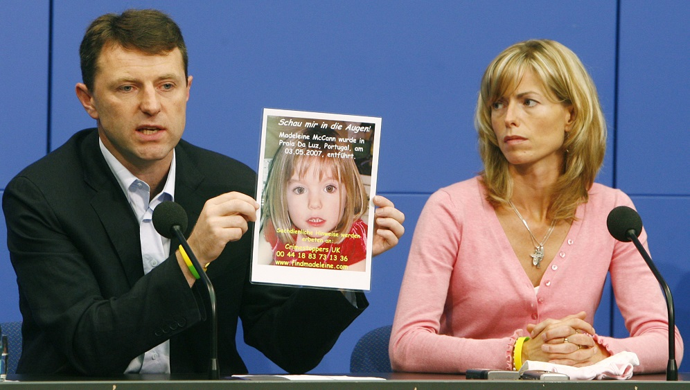 Gerry and Kate McCann hold a poster during a news conference in Berlin