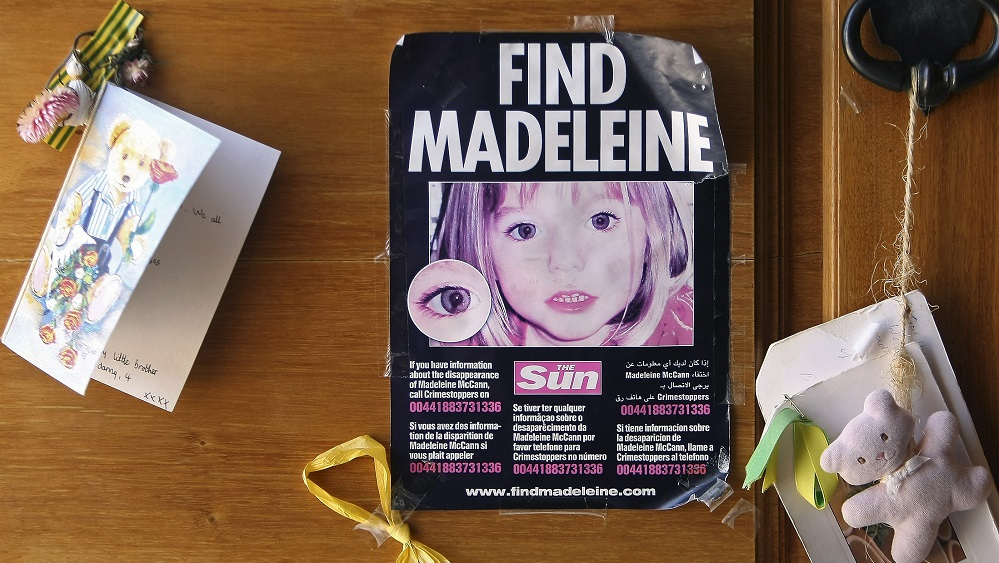 A poster of missing British girl Madeleine McCann is displayed on the church door of Praia da Luz beach resort in the southern Portuguese province of Algarve