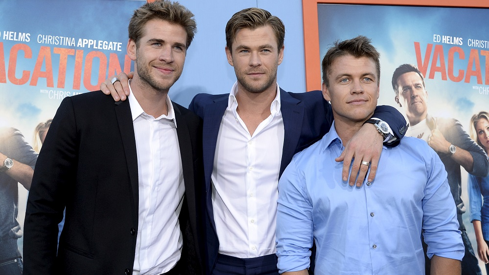 """Cast member Chris Hemsworth (C) poses with his brothers actors Liam Hemsworth (L) and Luke Hemsworth during the premiere of the film """"Vacation"""" at the Regency Village Theatre in the Westwood section of Los Angeles"""