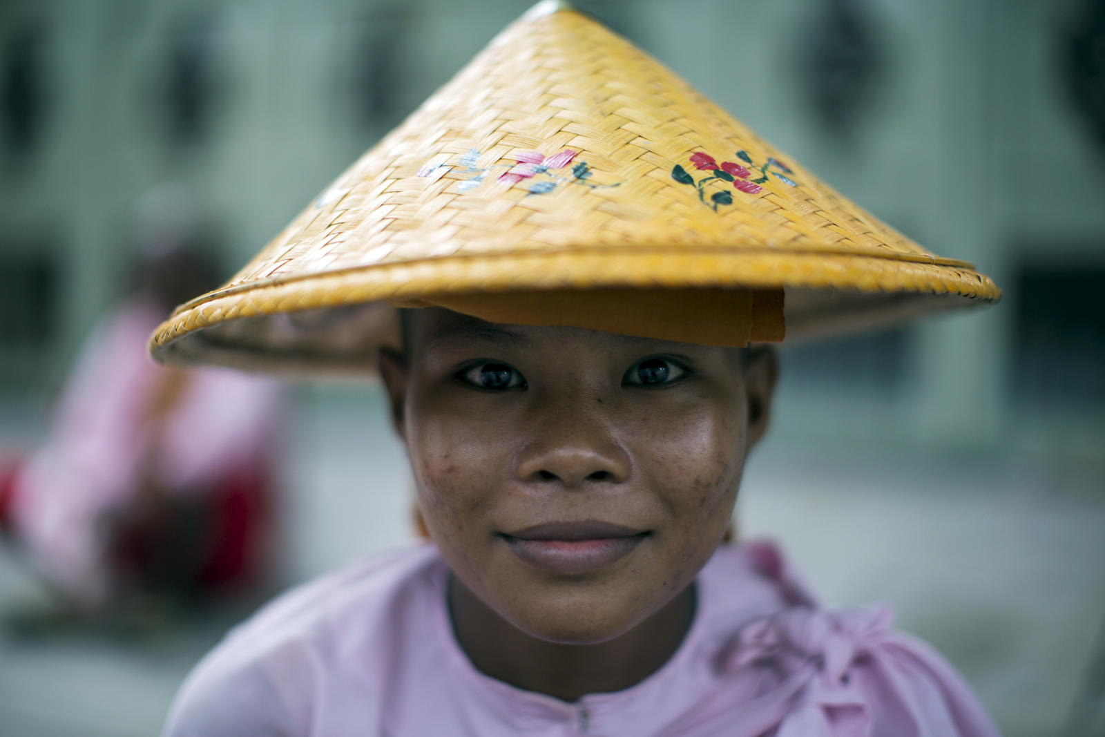 A Buddhist novice nun poses for a portrait in Mandalay