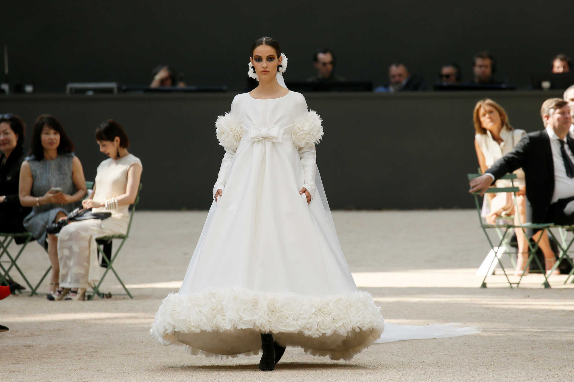 A model presents a creation by German designer Karl Lagerfeld as part of his Haute Couture Fall/Winter 2017/2018 collection for fashion house Chanel in Paris