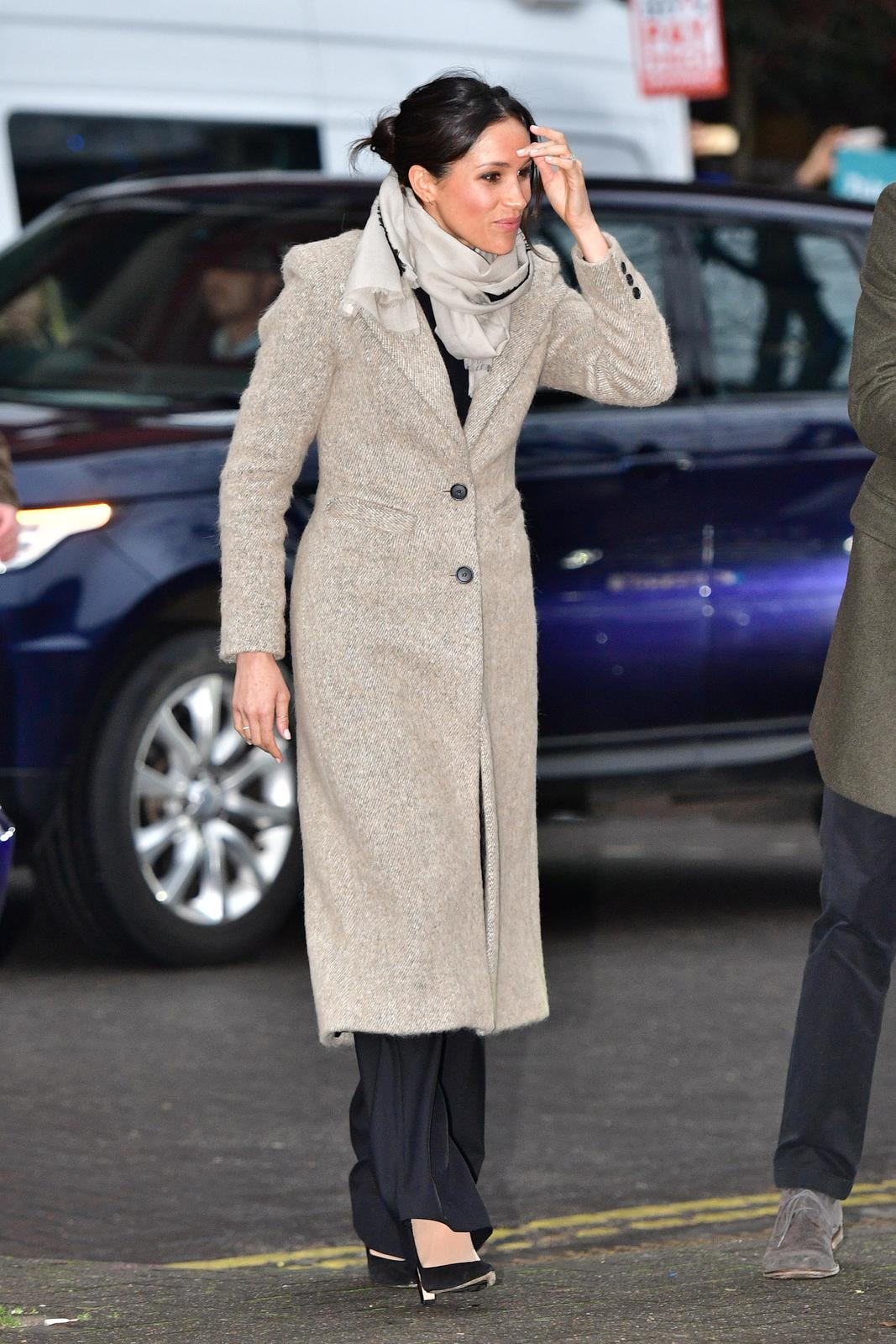 Meghan Markle arrives to visit radio station Reprezent FM, with her fiancee Britain's Prince Harry, in Brixton, London