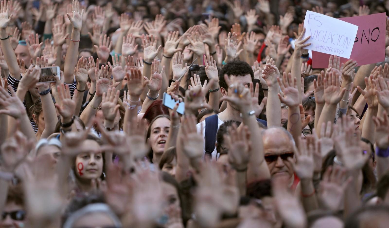 People shout slogans during a protest outside Ministry of Justice in Madrid