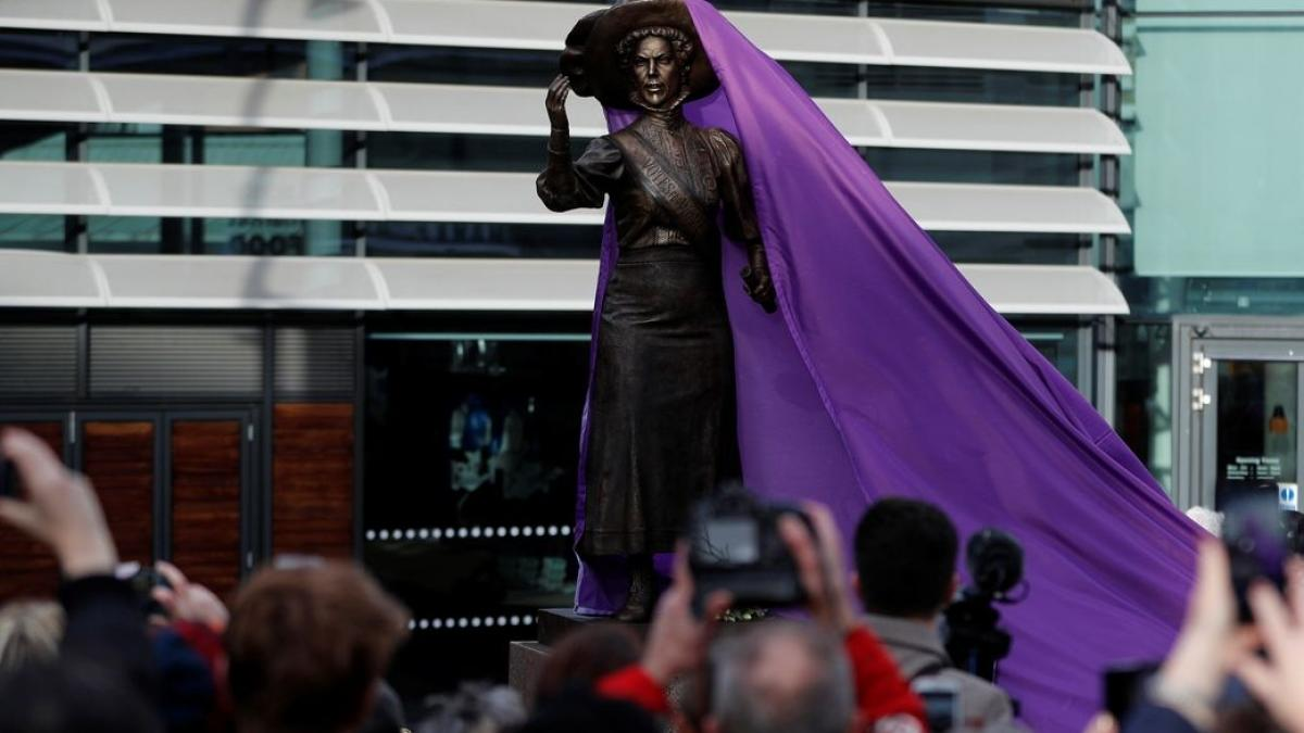 A bronze statue of suffragette Alice Hawkins is unveiled during an event to mark 100 years of votes for women in Leicester